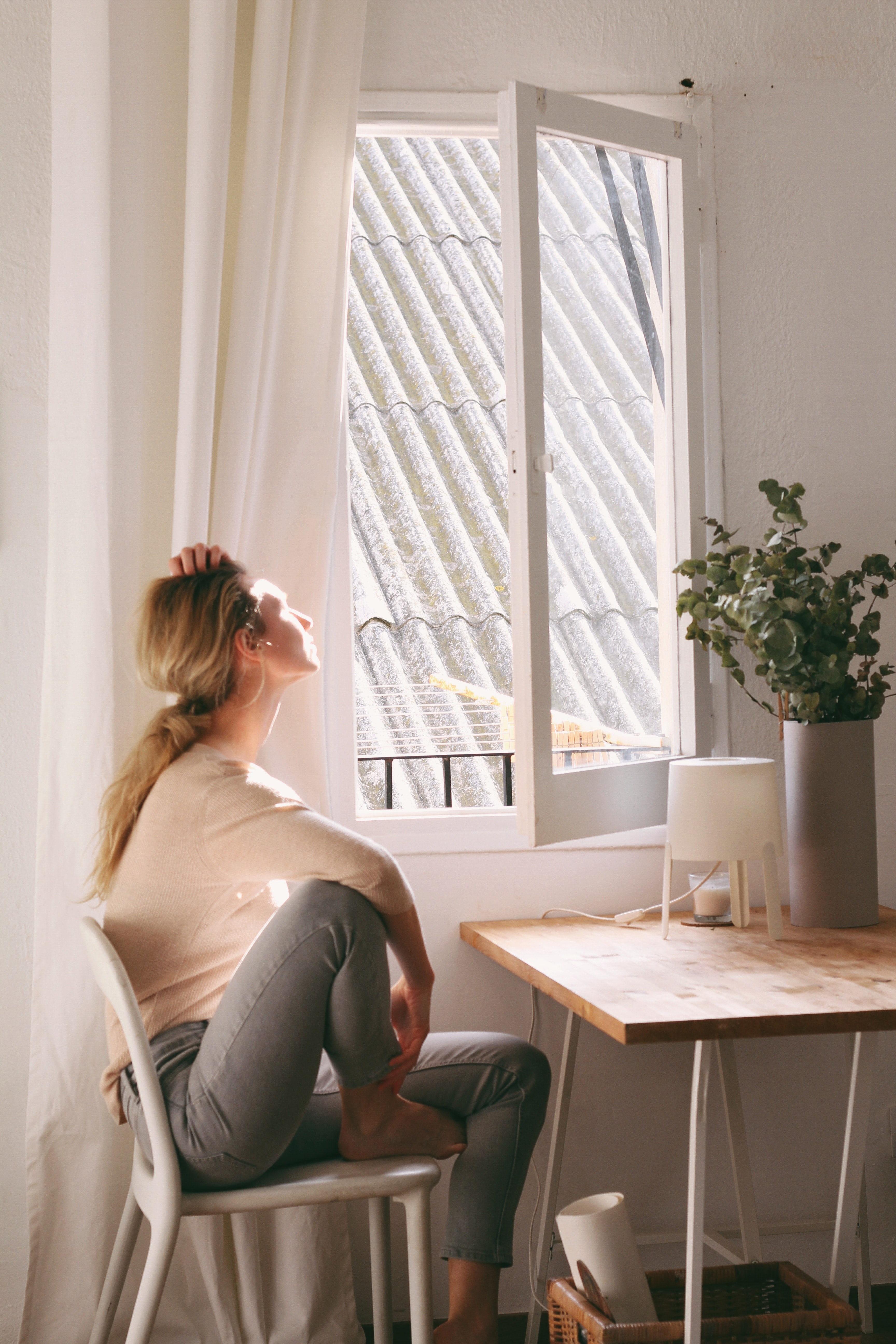 Woman sitting at a desk looking out the window