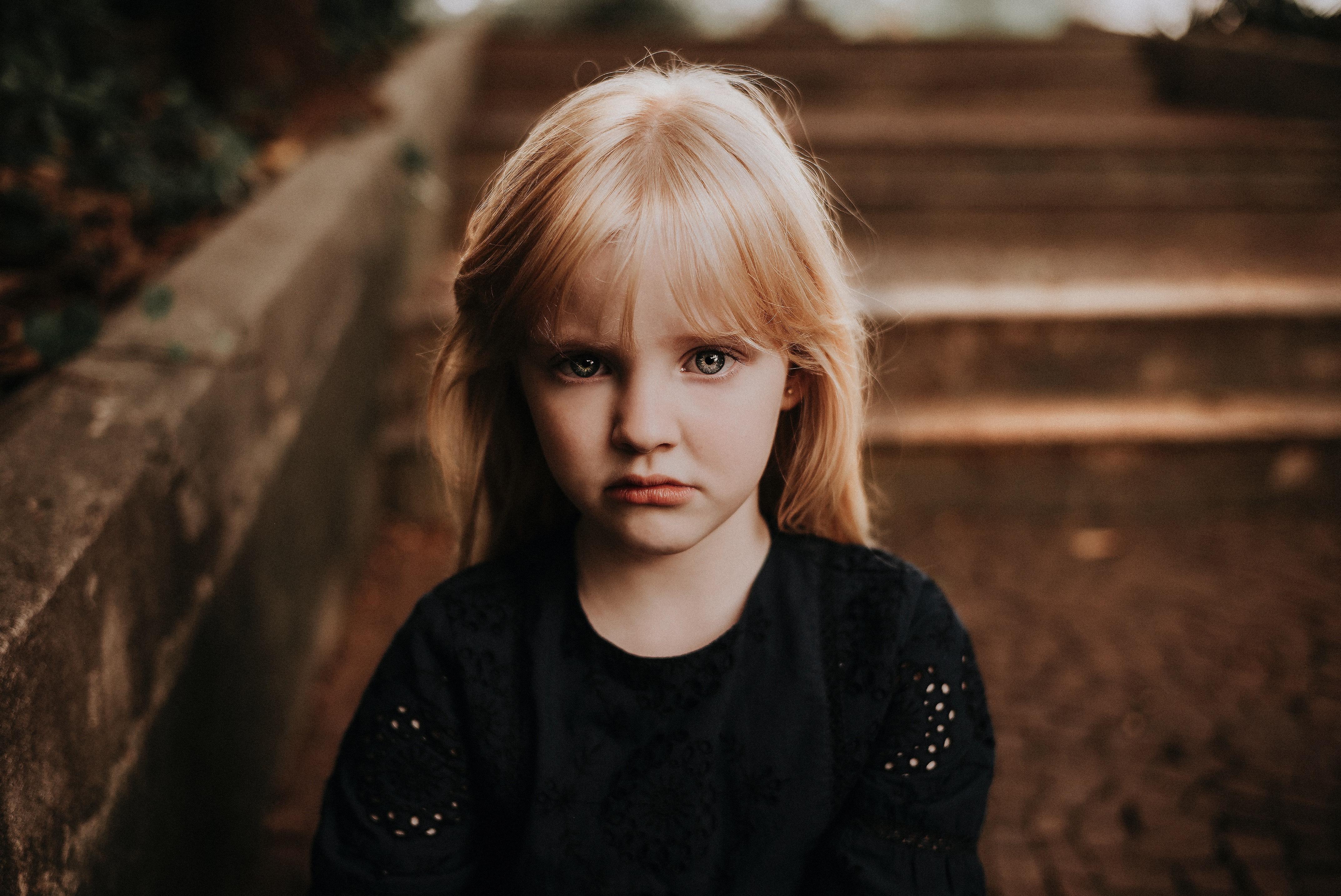 Little blonde girl looking sad