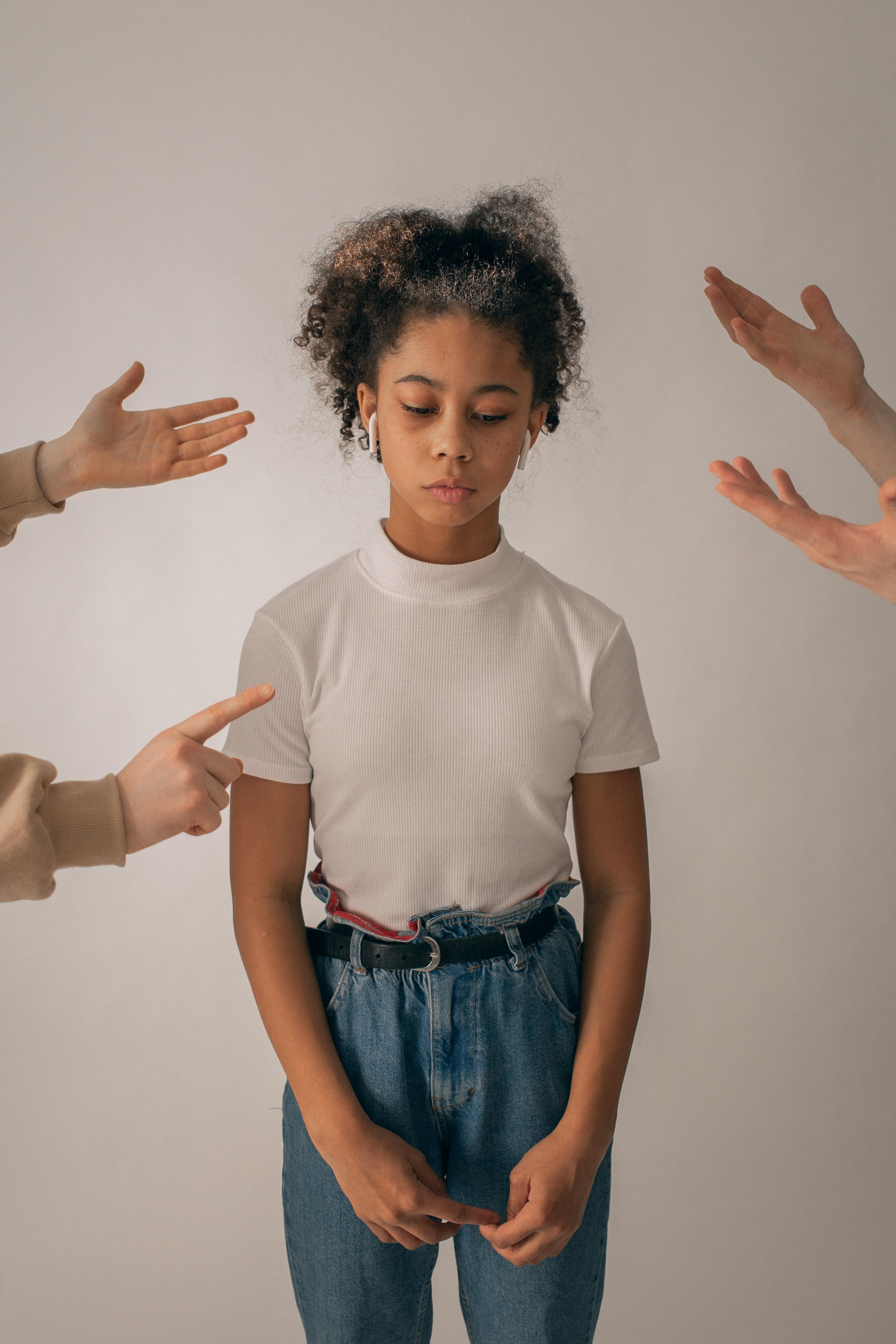 Child looking say between hands of arguing parents
