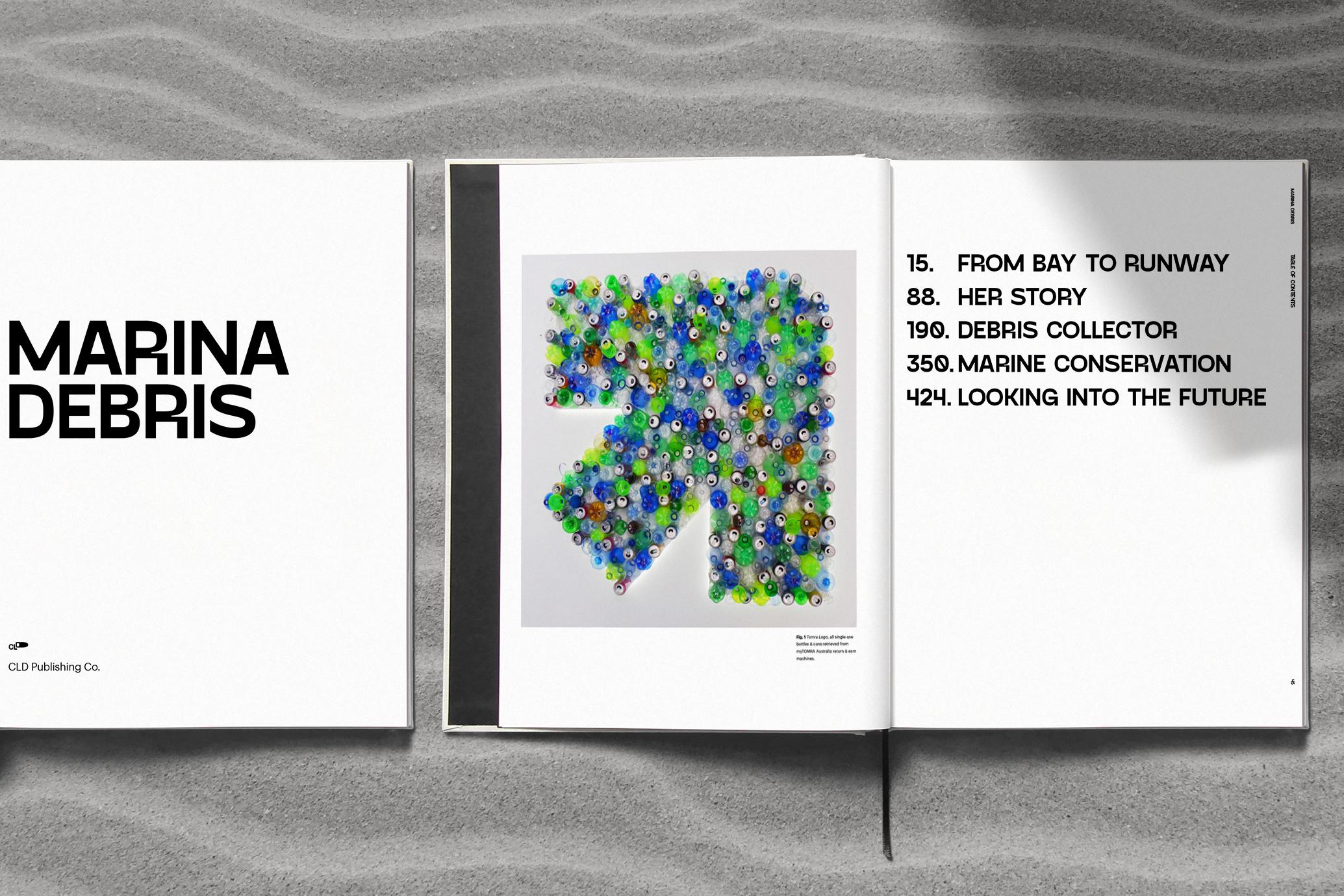 Book spreads design on sand