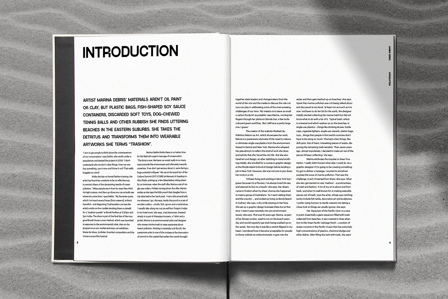 Book introduction spreads design on sand
