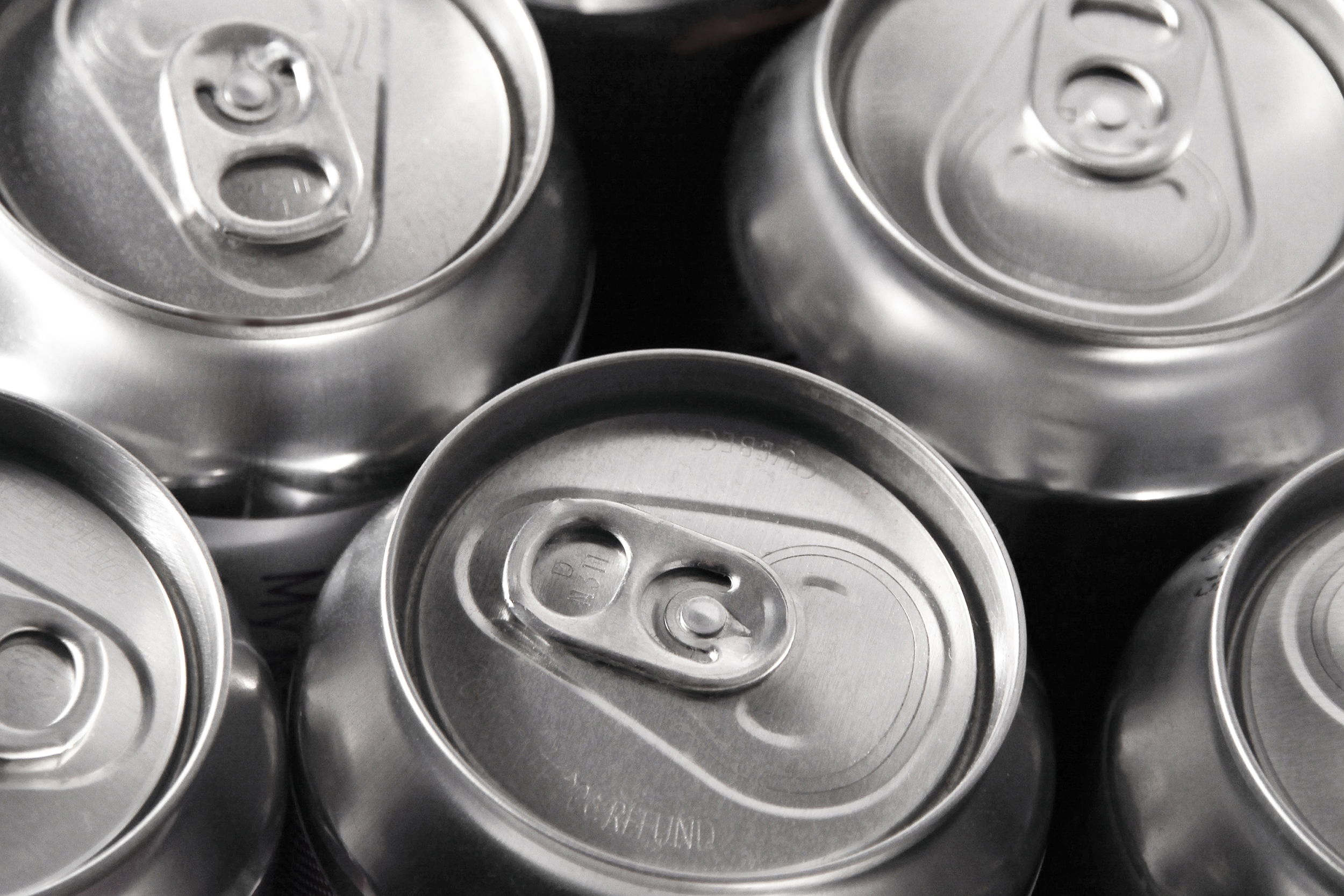 detailed shot of beer cans tops
