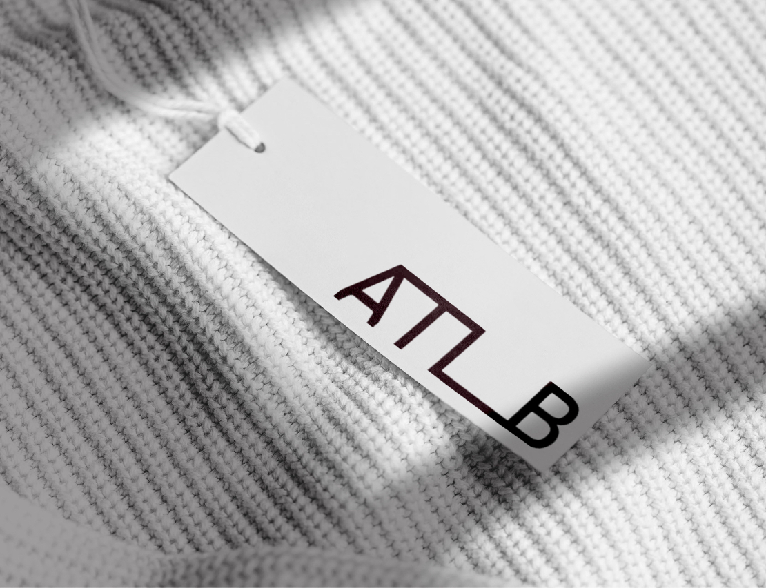 ATLB price tag design on white fabric