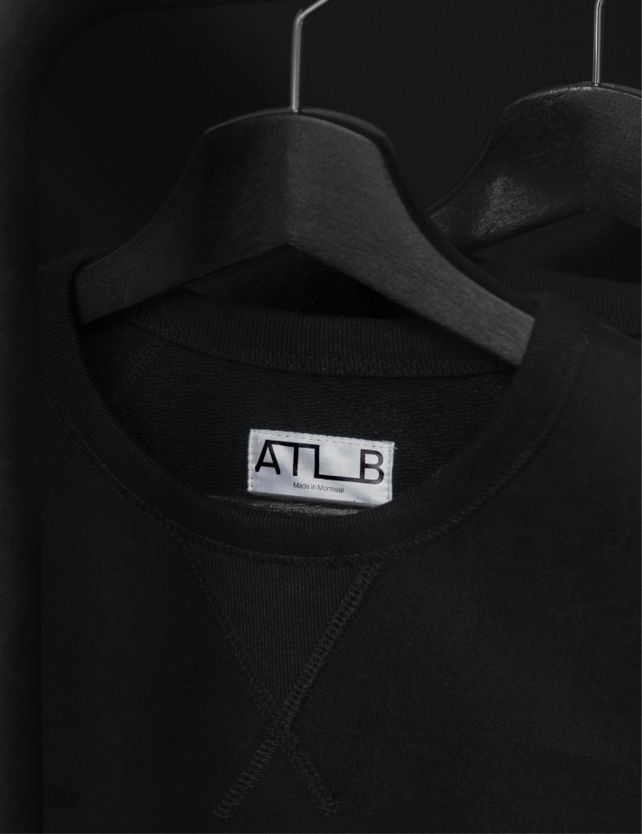ATLB sewn tag design on black