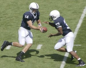 Running backs usually run from behind the quarterback for a successful handoff.