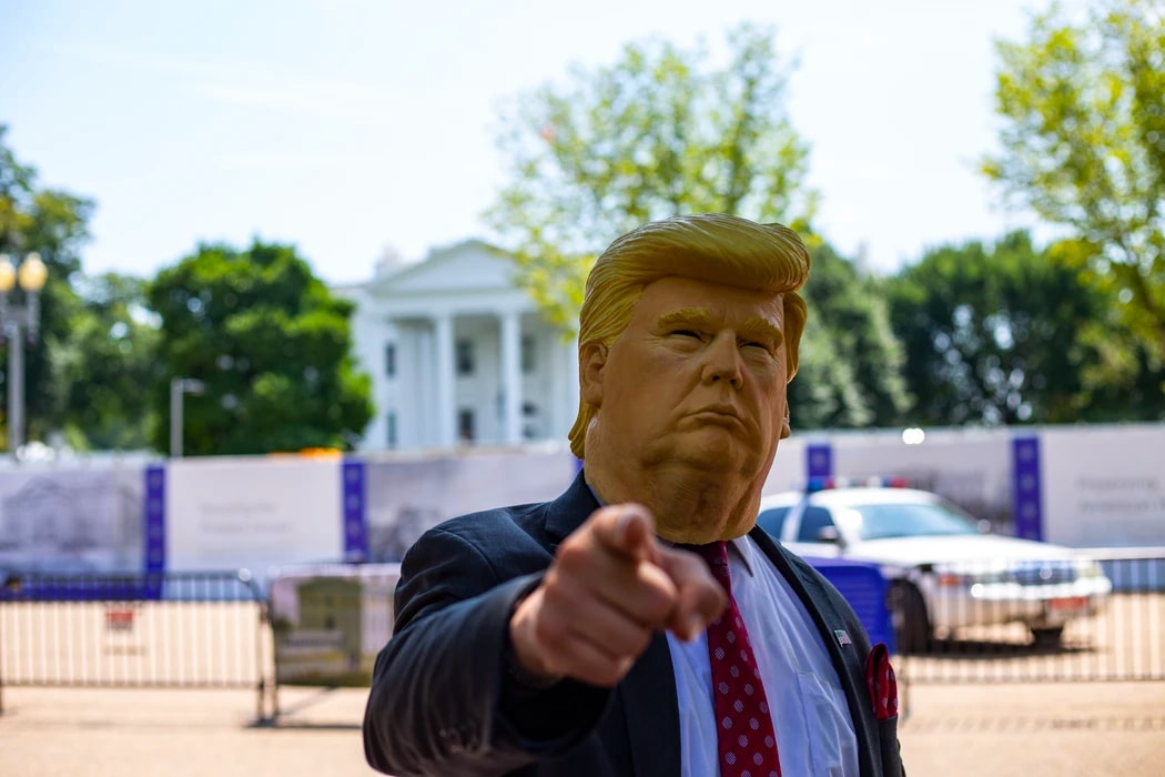 A person wearing Donald Trump mask