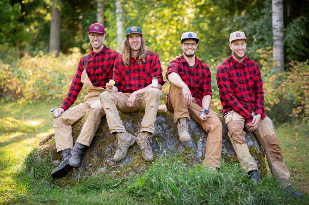 Four men sitting on rock