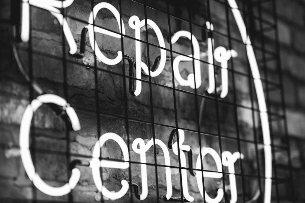 Repair center sign – as the climate impact of consumption is huge, repairing things when possible is sustainable.