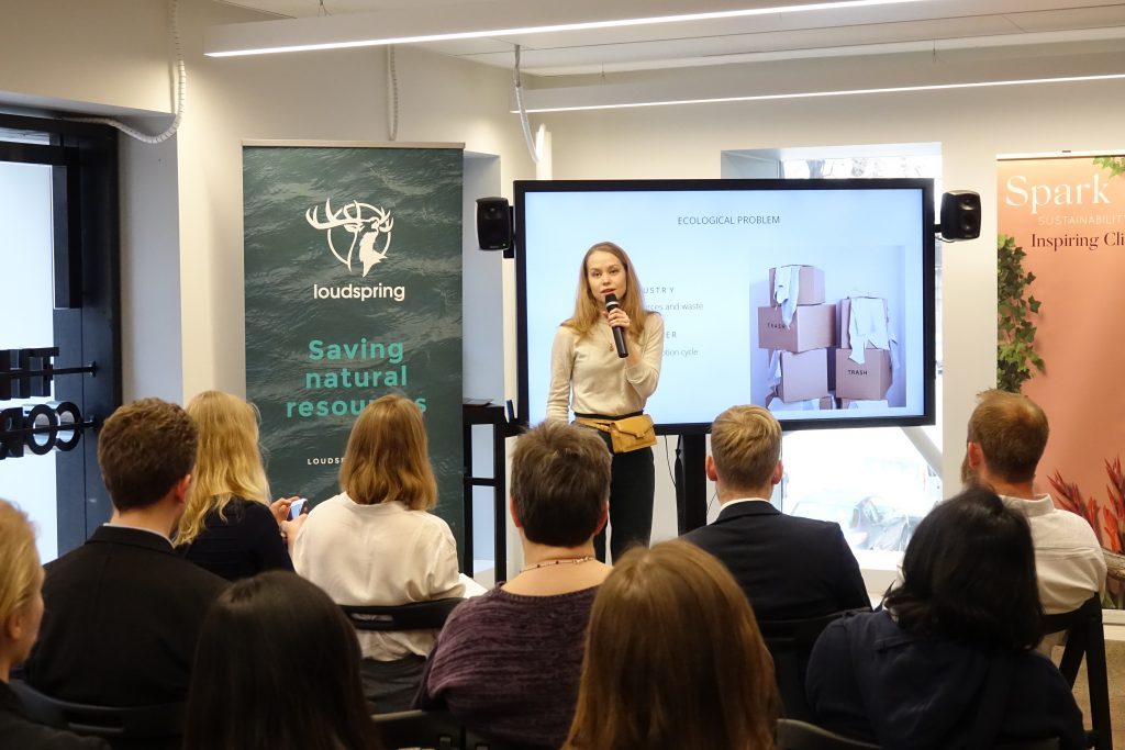 CEO of sustainable handbags company Lovia on stage talking about how to make the fashion industry more sustainable.