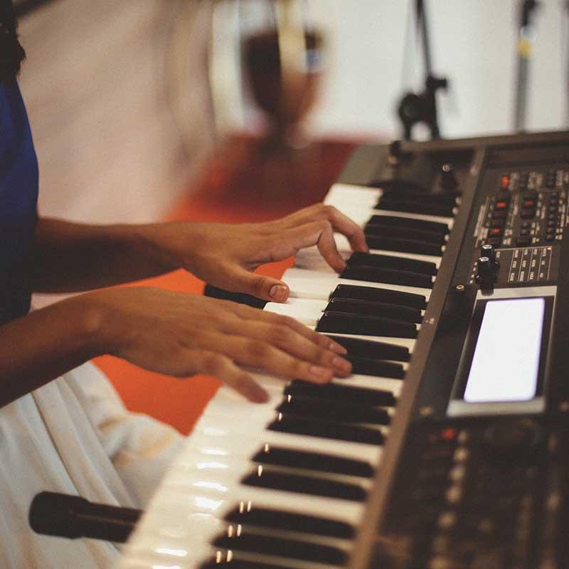 Woman using synthesizer