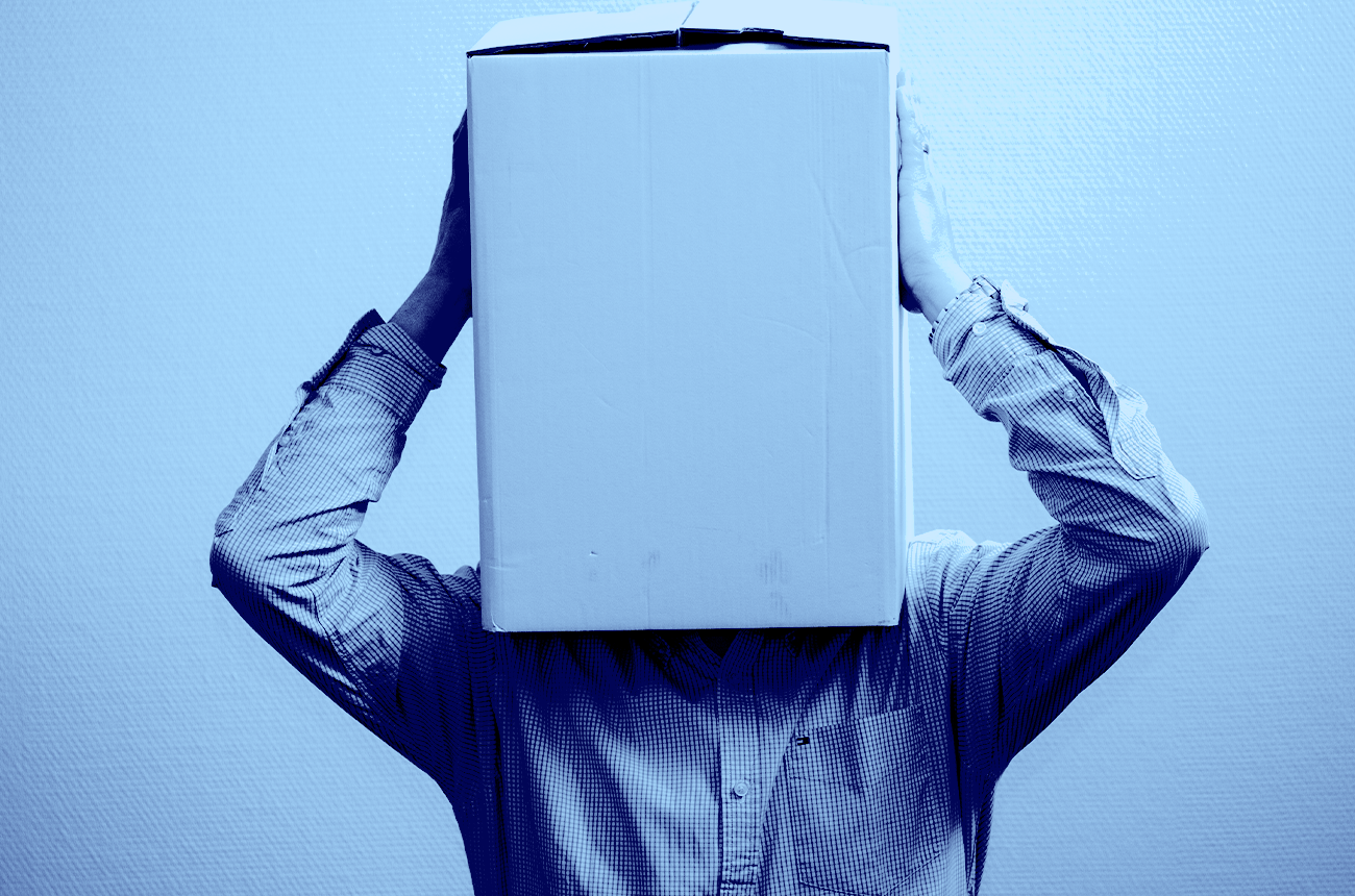 confused man with box on his head