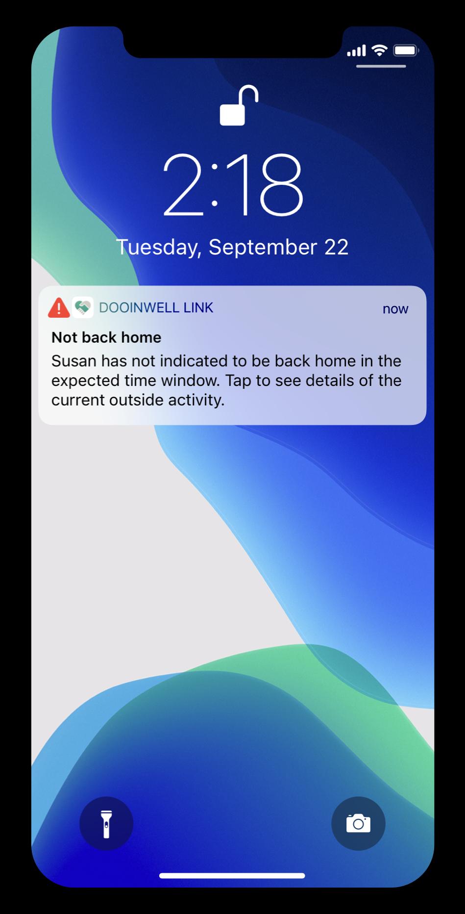 Dooinwell alert on an iPhone lock screen