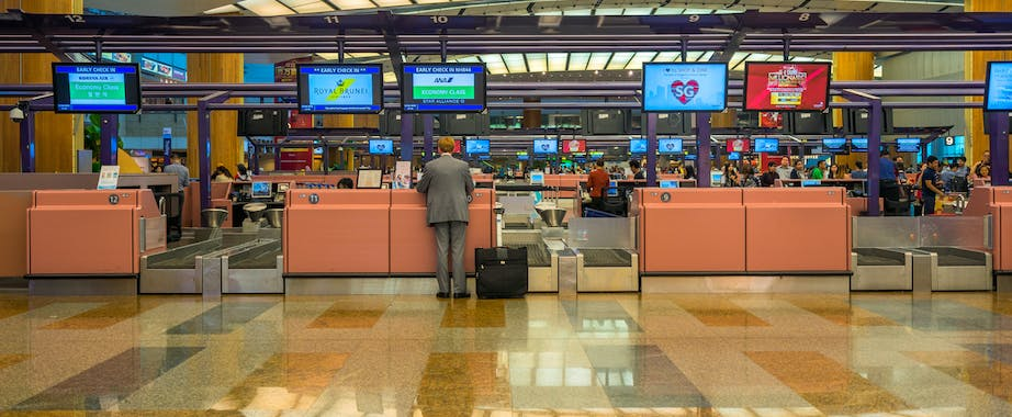 Man in business suit at check-in counter