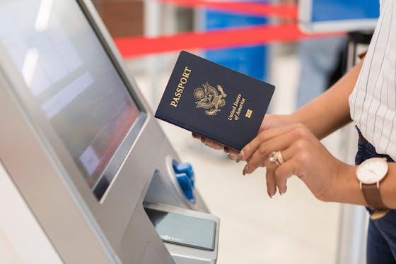 Woman preparing to scan passport