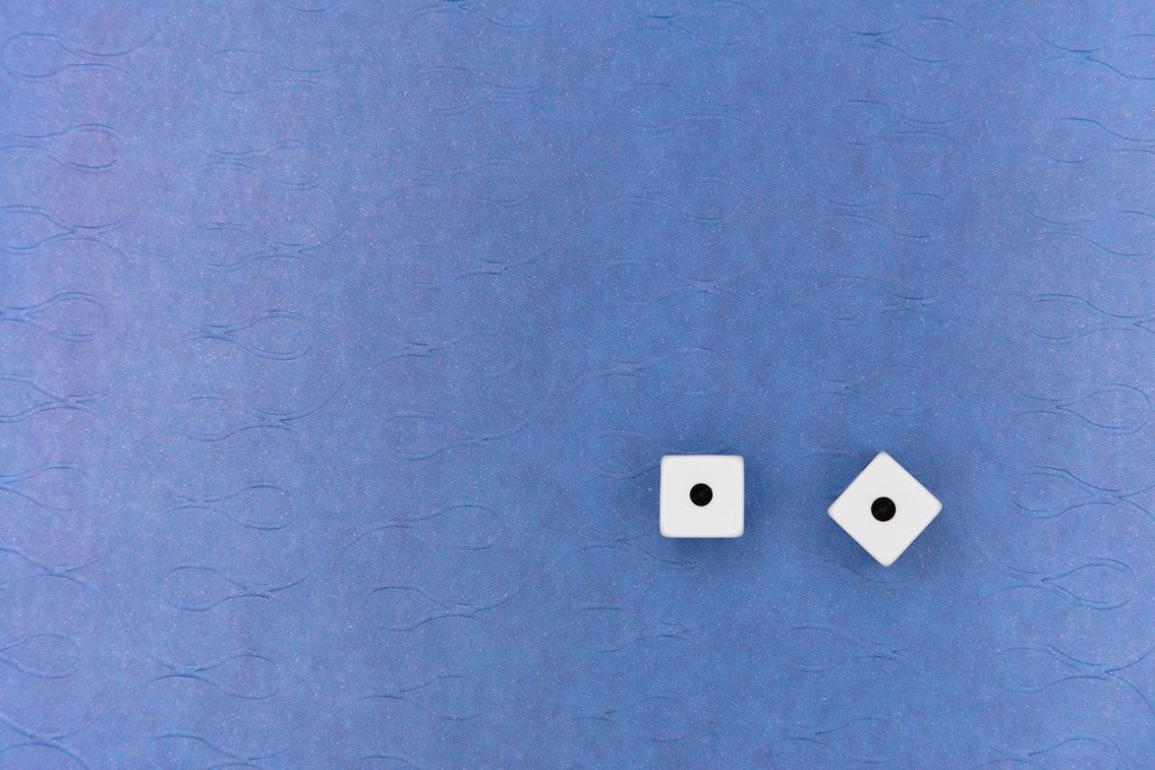 Snake eyes dice on blue background