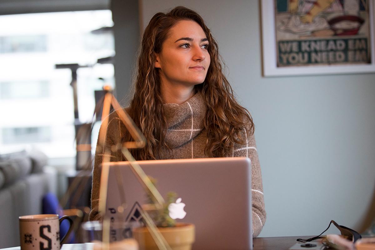 High school teacher leads a virtual class from home