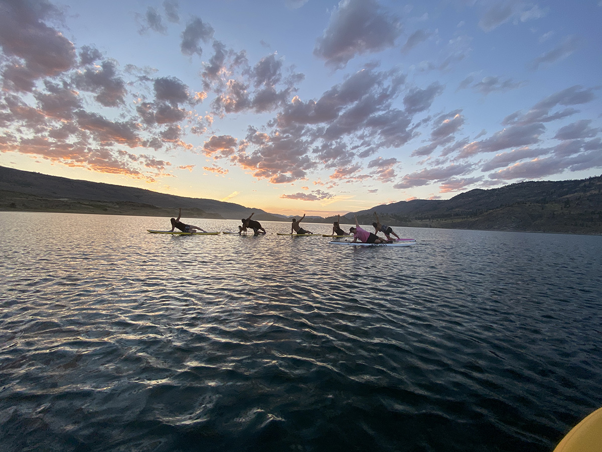 Paddleboard yoga class on the Okanogan River with sunset