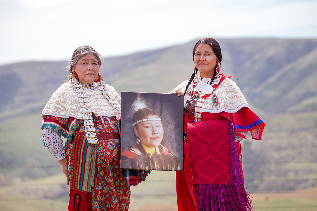 Mildred Quaempts and Merle Kirk hold a portrait of Mavis Kirk-Greeley on the Warm Springs Indian Reservation