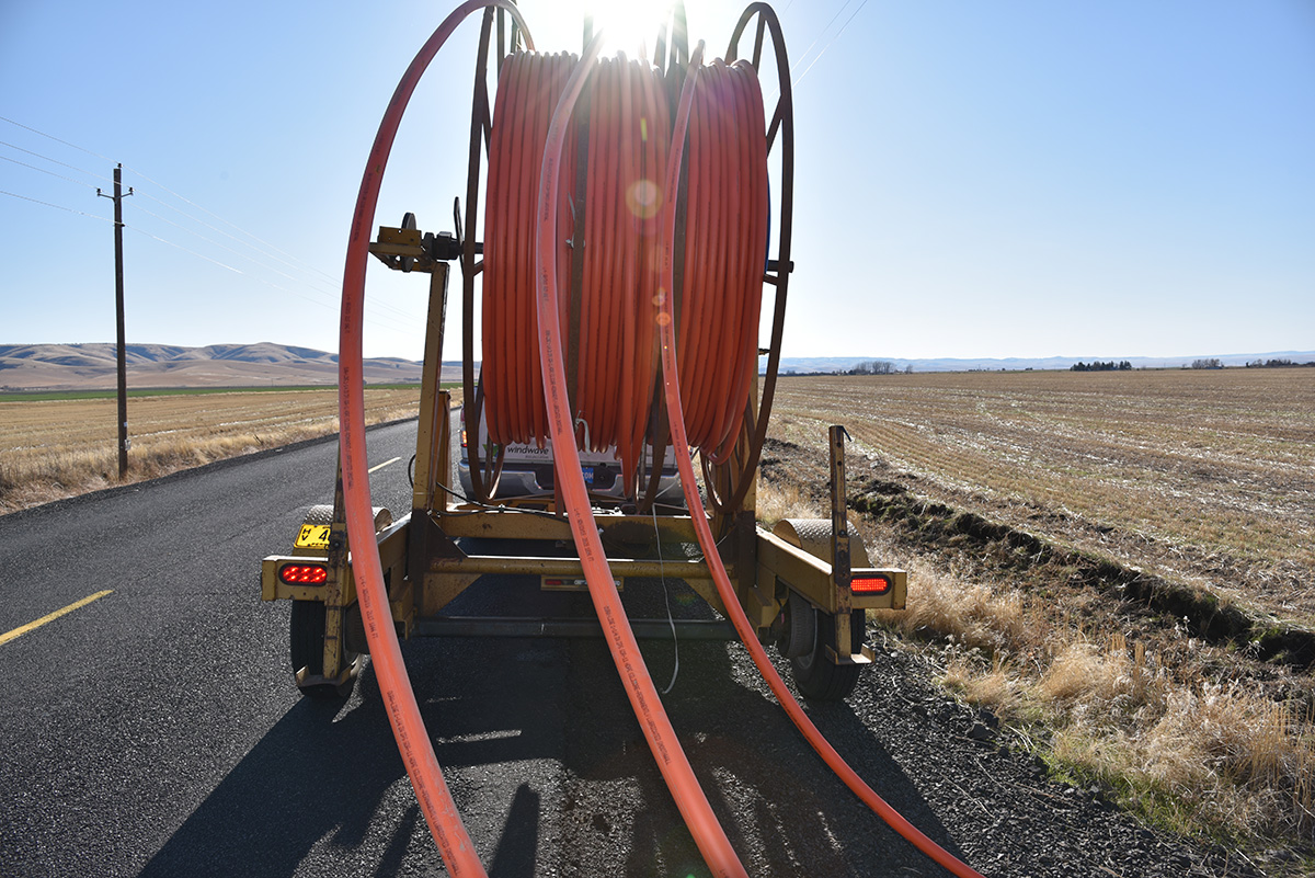Work crews install cable on the Umatilla Indian Reservation