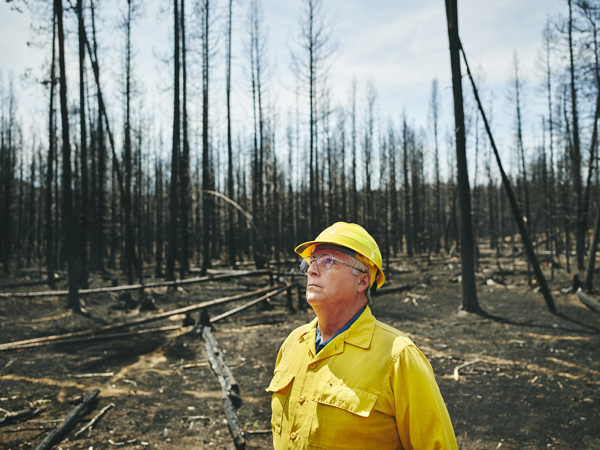 Tribal Chairman looks out over ancestral lands of the Klamath Tribes that recently burned during The Bootleg Fire