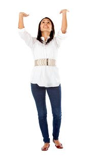 Casual woman lifting an imaginary object isolated on white