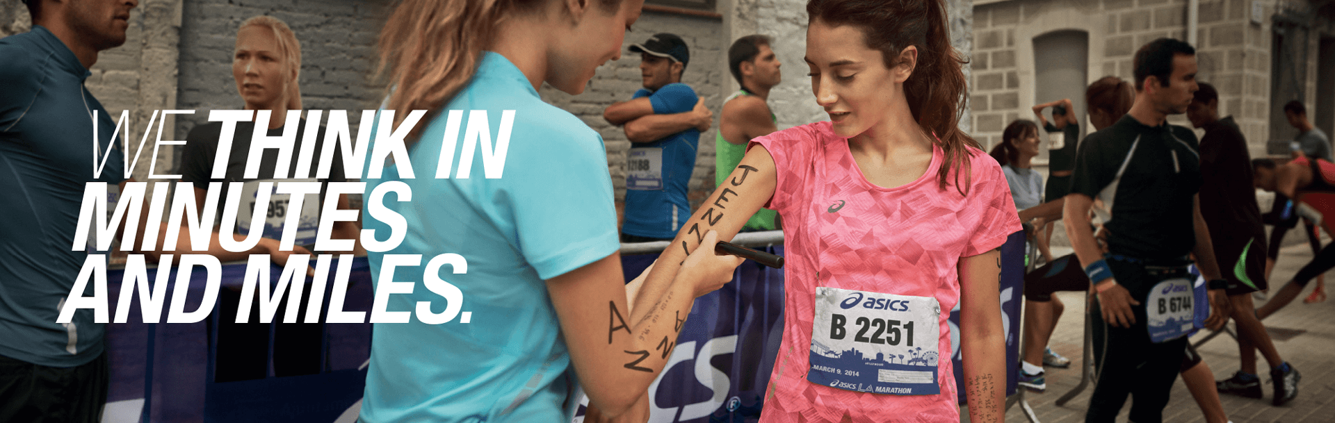 ASICS banner image featuring two female runners