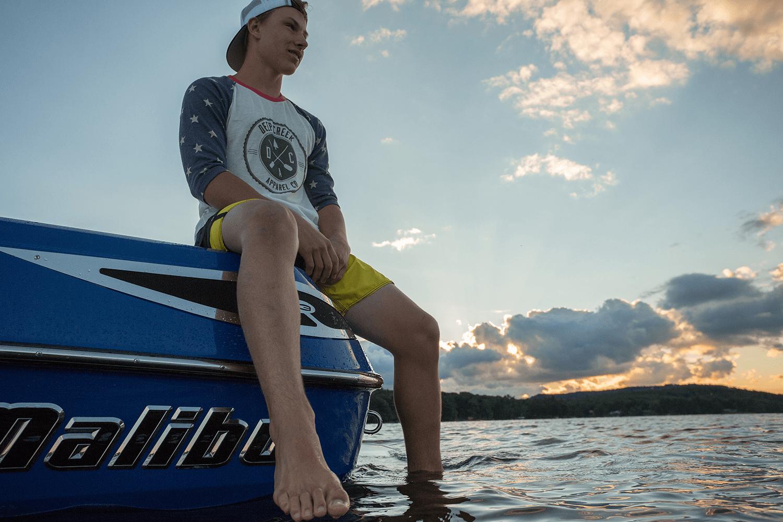 Deep Creek Apparel brand image on a boat