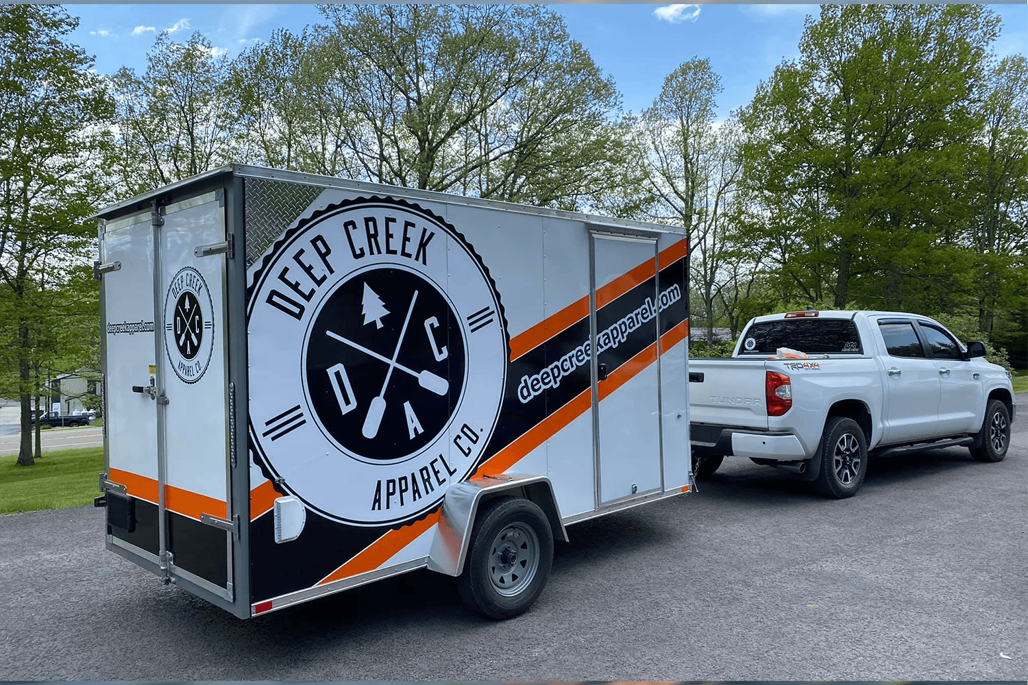 Deep Creek Apparel image of company truck and trailer with logo