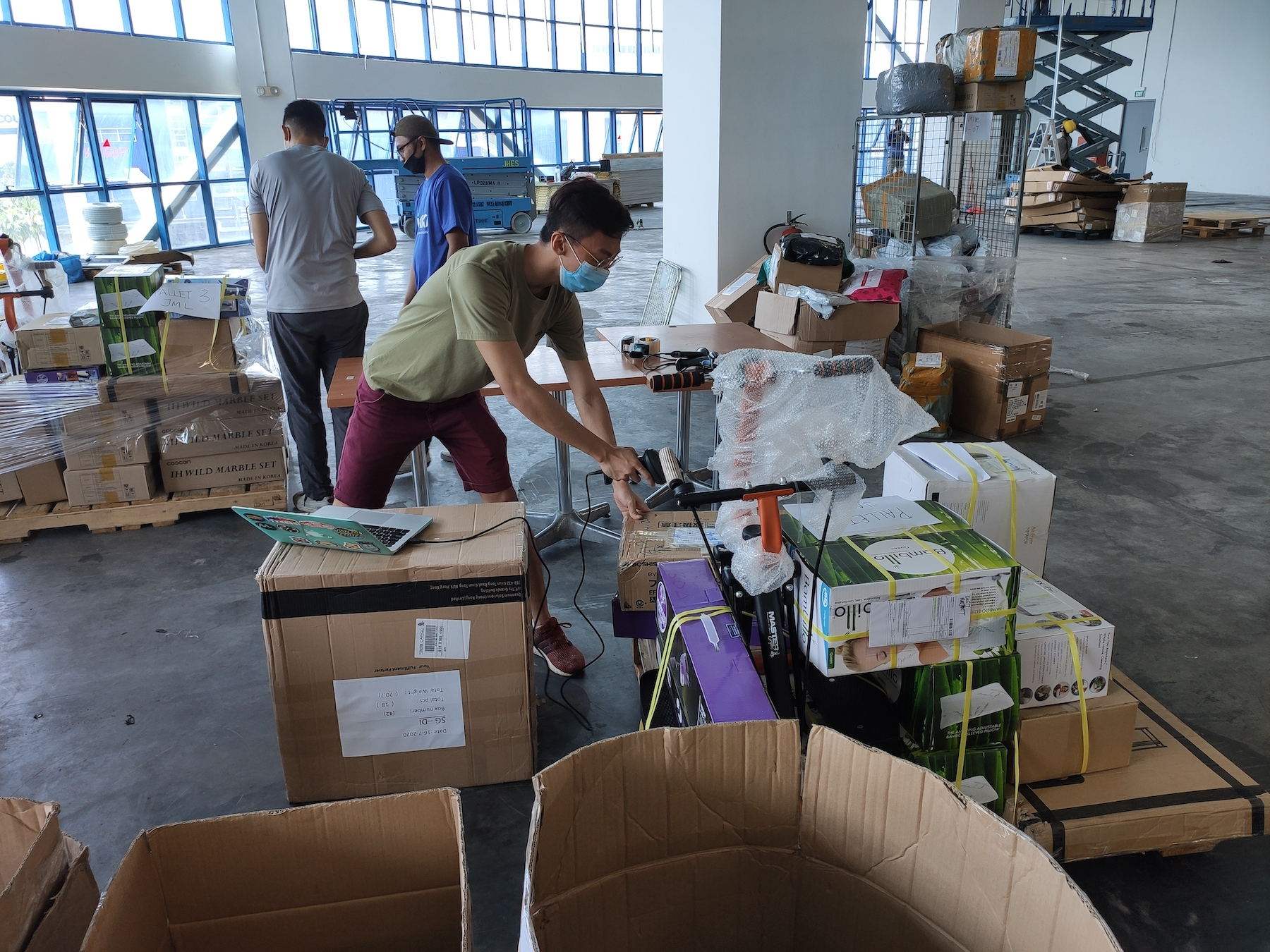 office staff volunteering in the warehouse