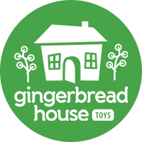 The Gingerbread House Toys logo is a white cartoon house with a cartoon tree on either side and the name of the business beneath it on a light green background.