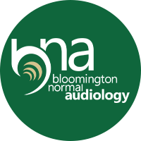 The Bloomington Normal Audiology logo with the letters B, N, and A all in lowercase with a symbol for sound waves and the name of the business on a kelly green background.