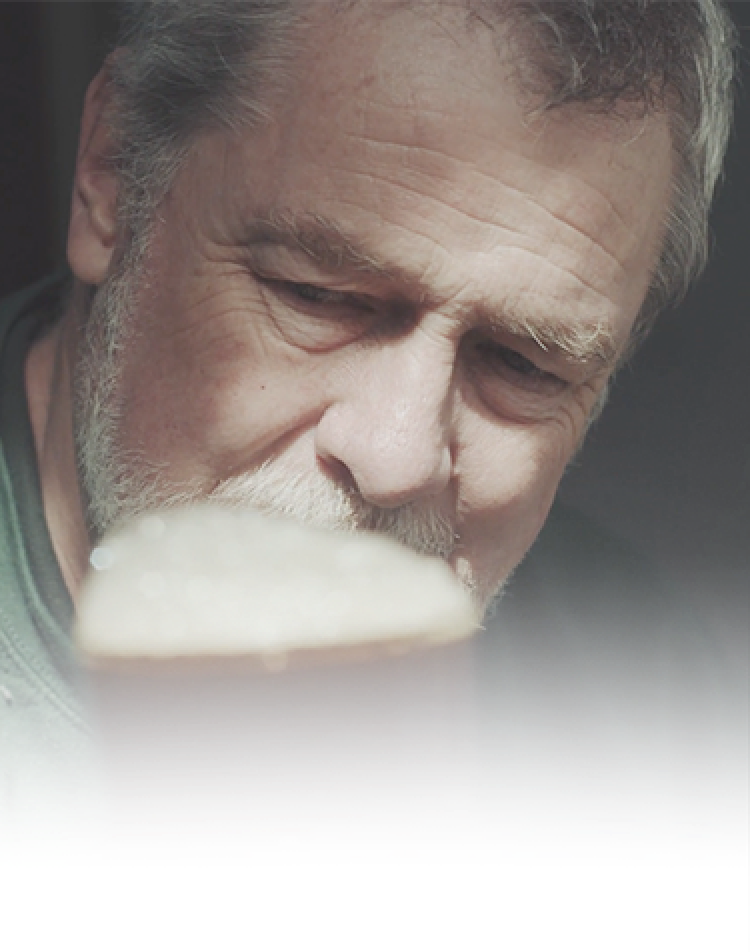 Photo of Guy looking at a beer