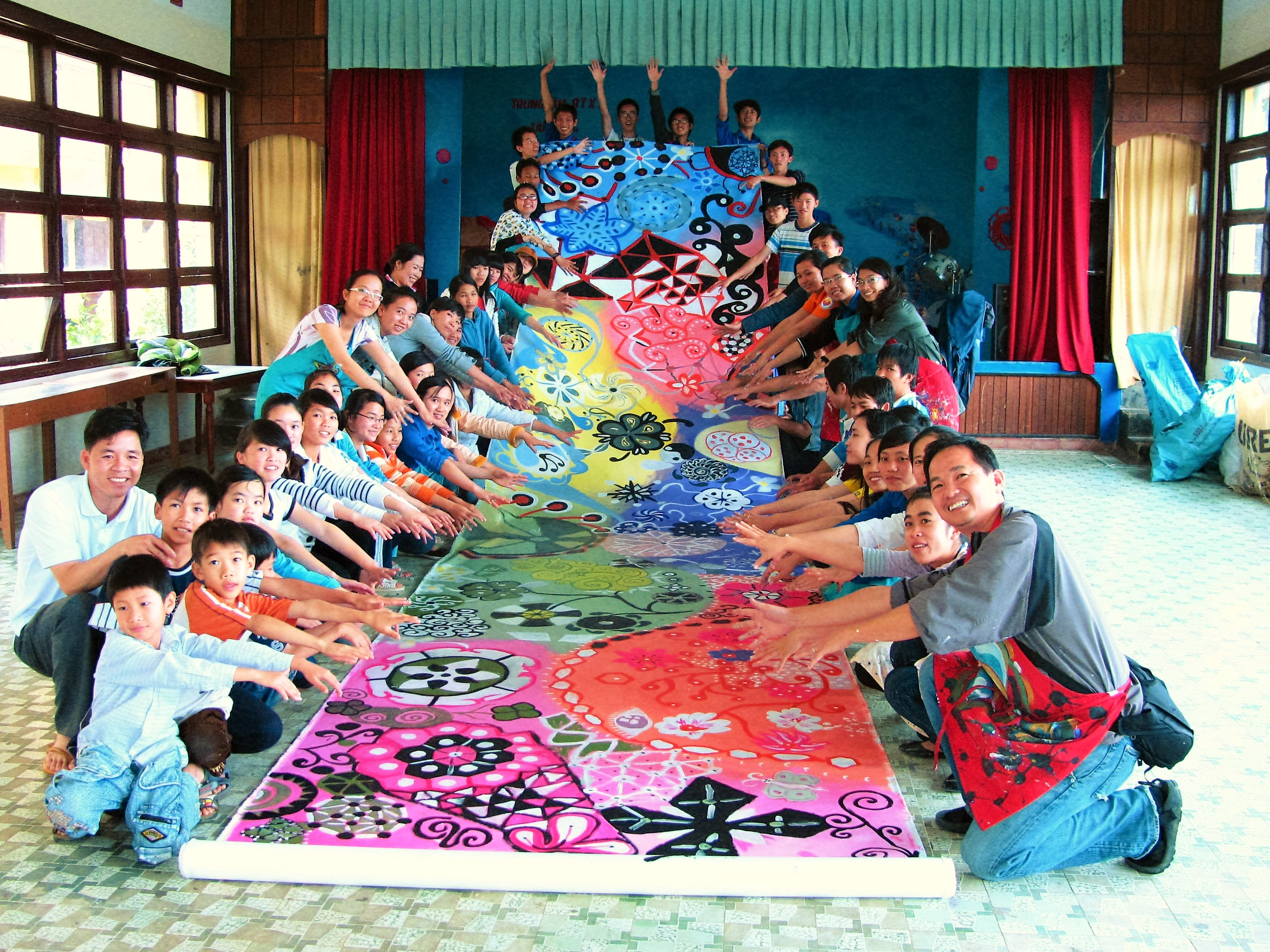 Circle Painting can produce very large, colorful banners or murals