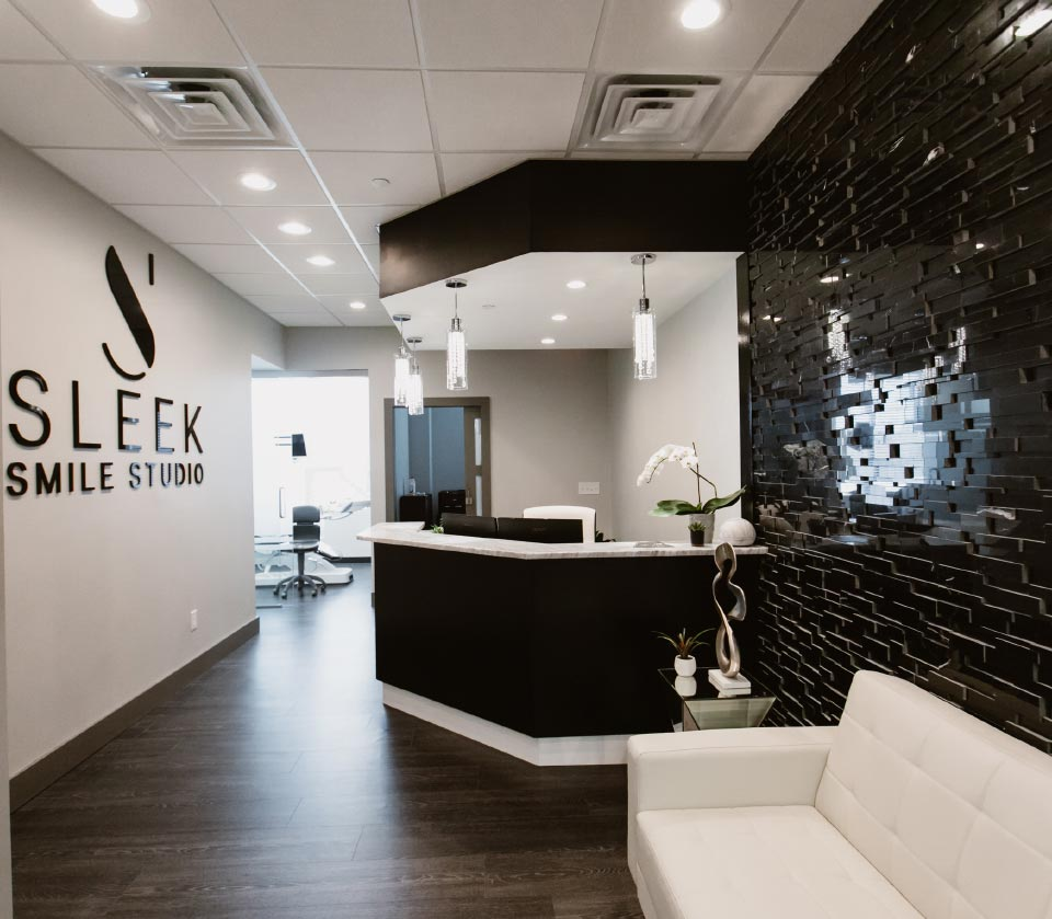 Photo of the Sleek Smile Studio lobby and front desk area