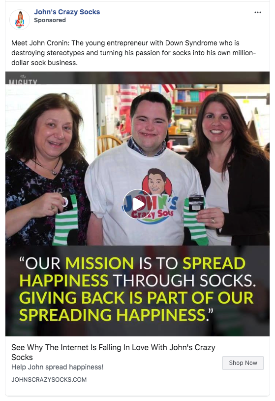A Facebook advertisement for John's crazy socks. It's a video ad that highlights the mission of the company and the different charities they support. 'Giving back is part of our spreading happiness.'
