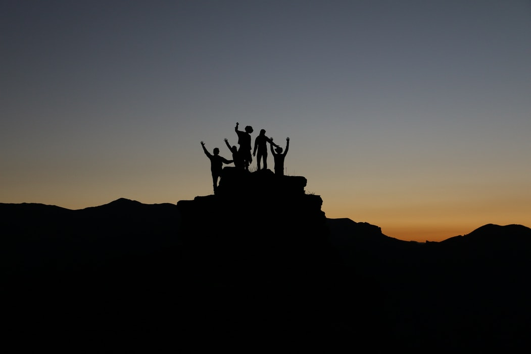 photo with people on top of a mountain