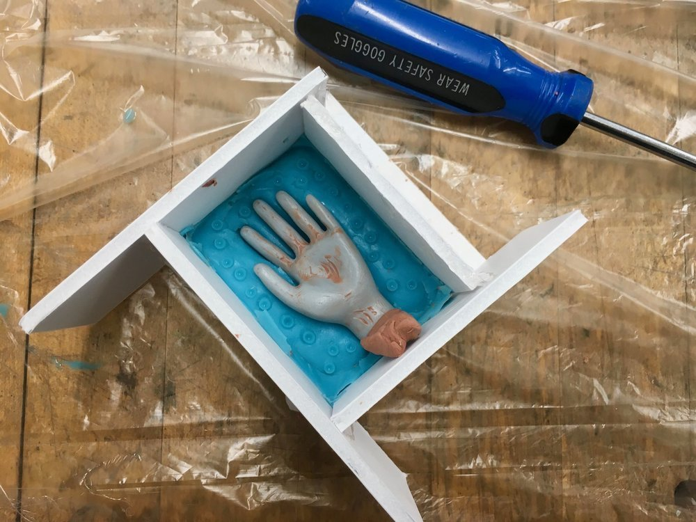 Preparing for the second part of the mold. Clay placed at the wrist of the hand in order to have a pouring spot for the resin (later).