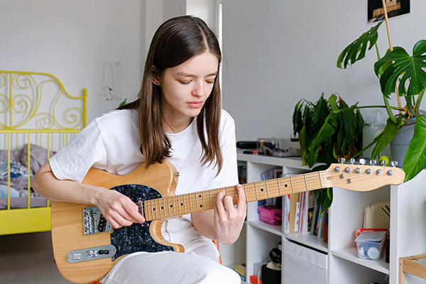 Sara studies electric guitar at Greenwich Arts Academy