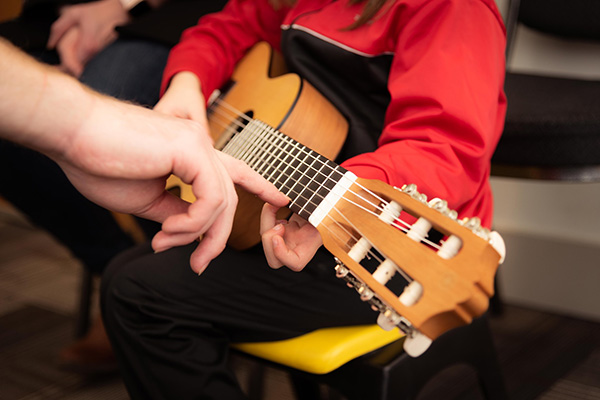 Everyone loves learning guitar at Greenwich Arts Academy