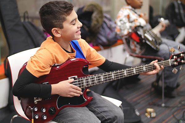 Henry studies bass at Greenwich Arts Academy