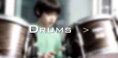 Omi studies drums at Greenwich Arts Academy