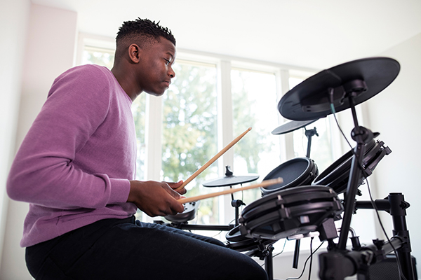 Kyle studies drums at Greenwich Arts Academy