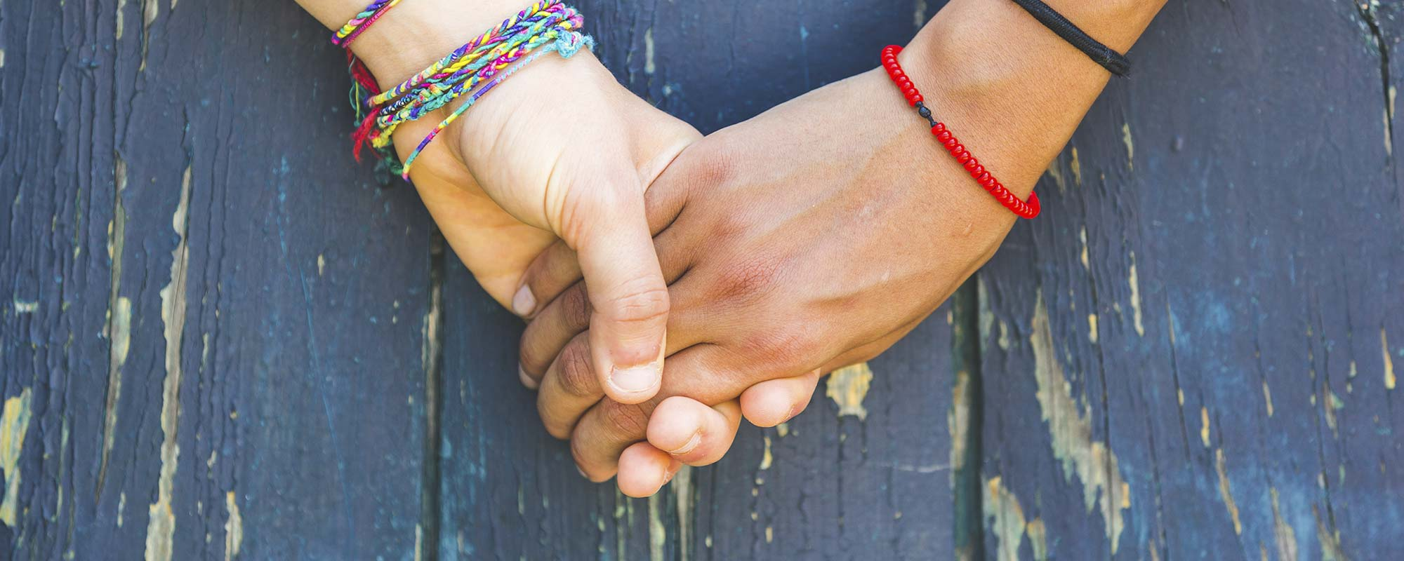 Close up of two hands, hand holding