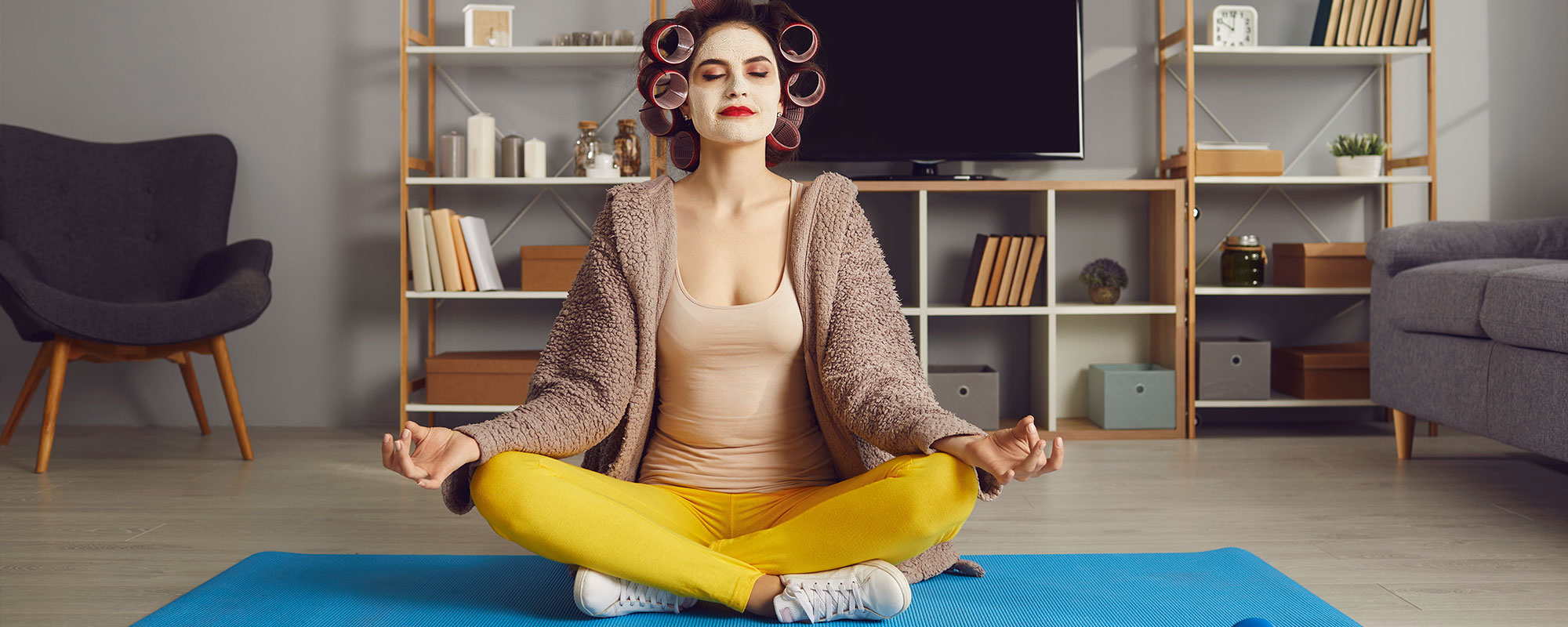A woman meditating in her living room