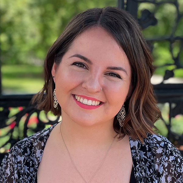 A headshot photo of Sara