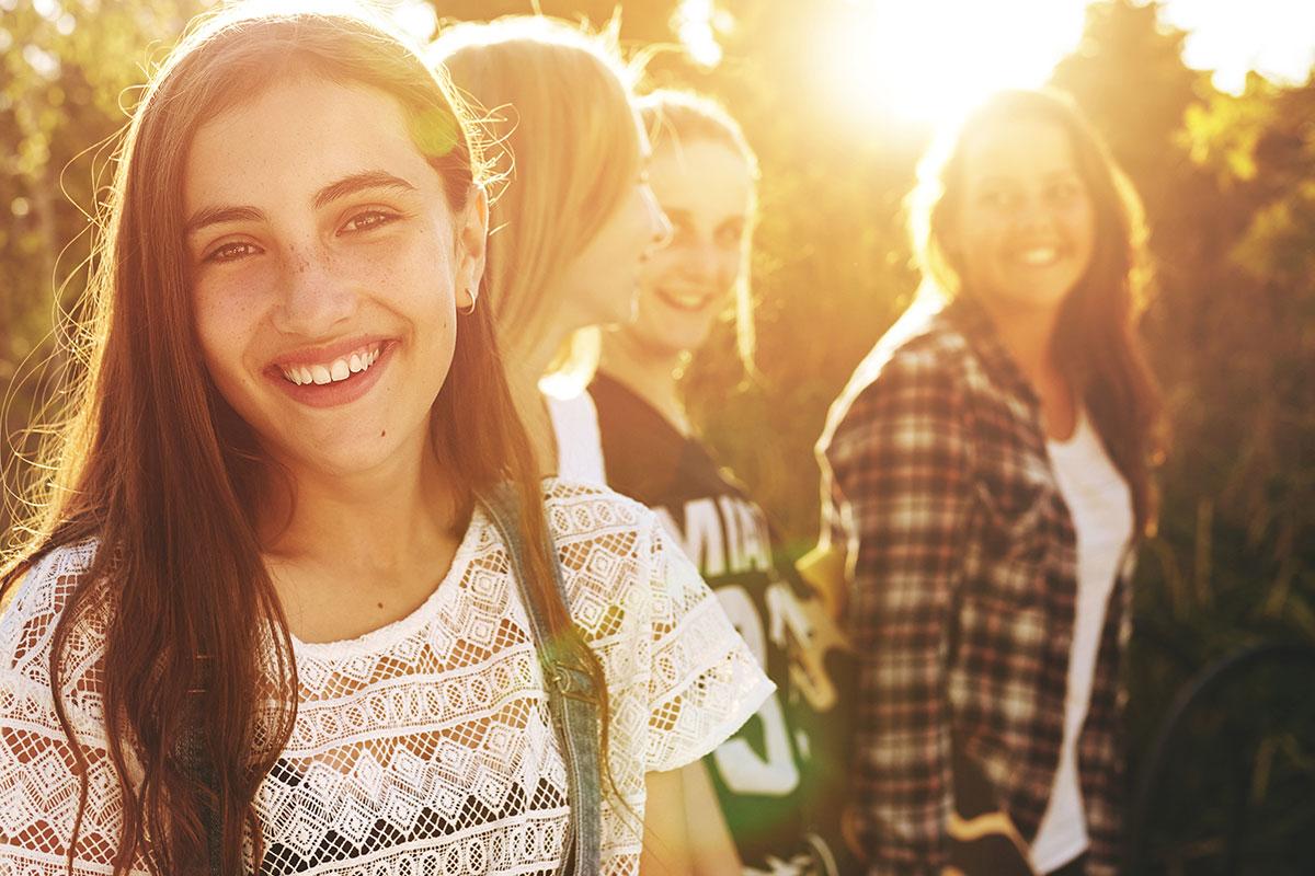 A group of young women having fun outdoors.