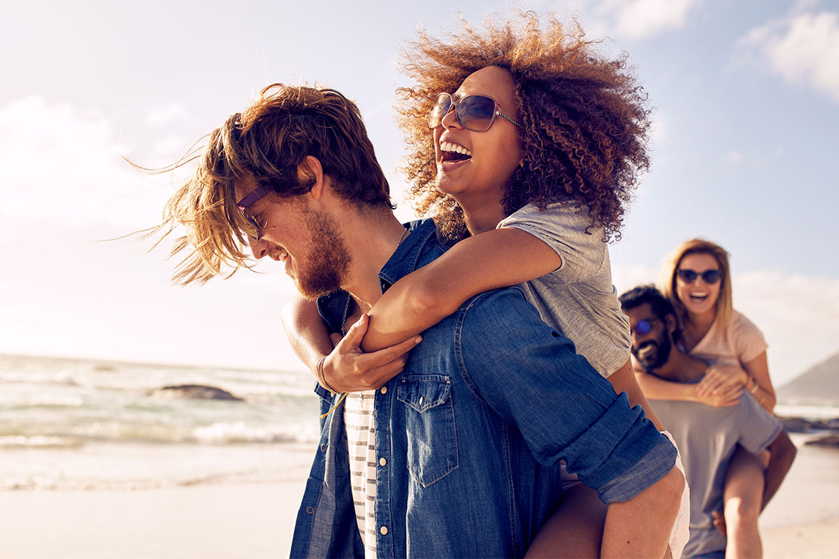 two couples having fun on a beach