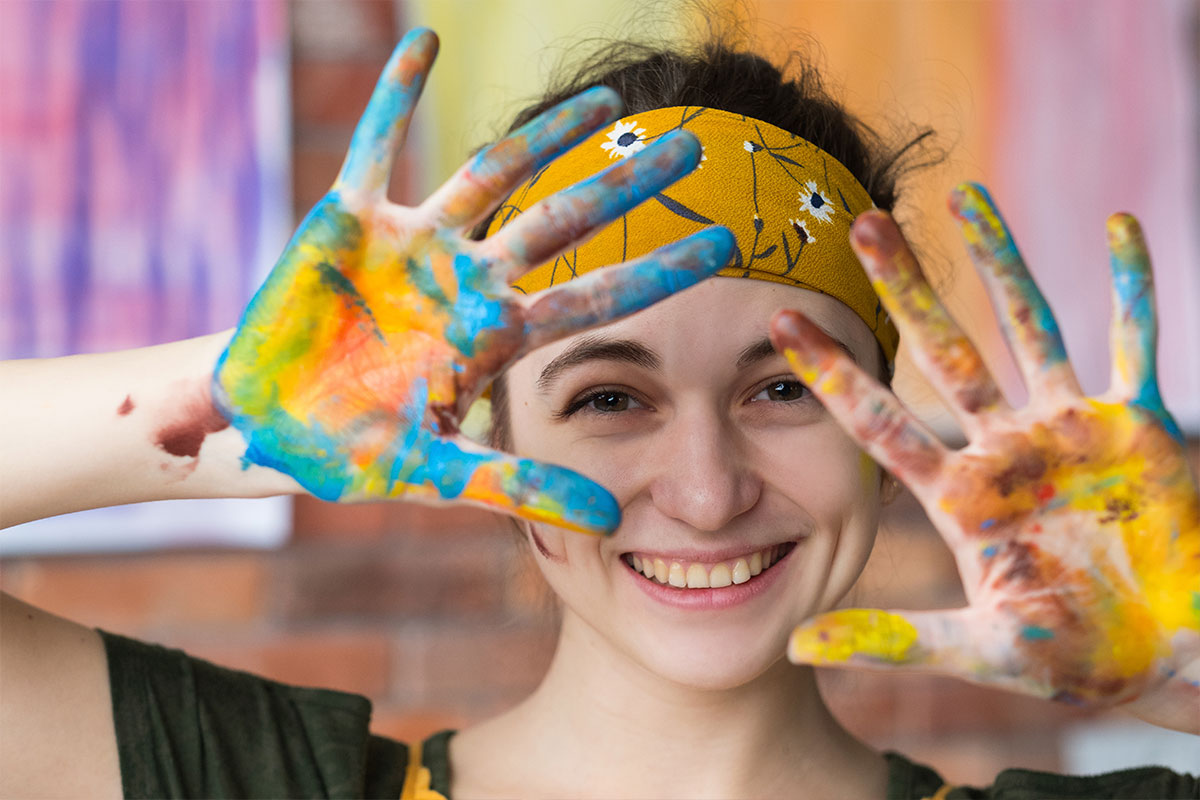 a young person enjoying art therapy