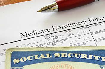 Medicare Enrollment form and a social security card.