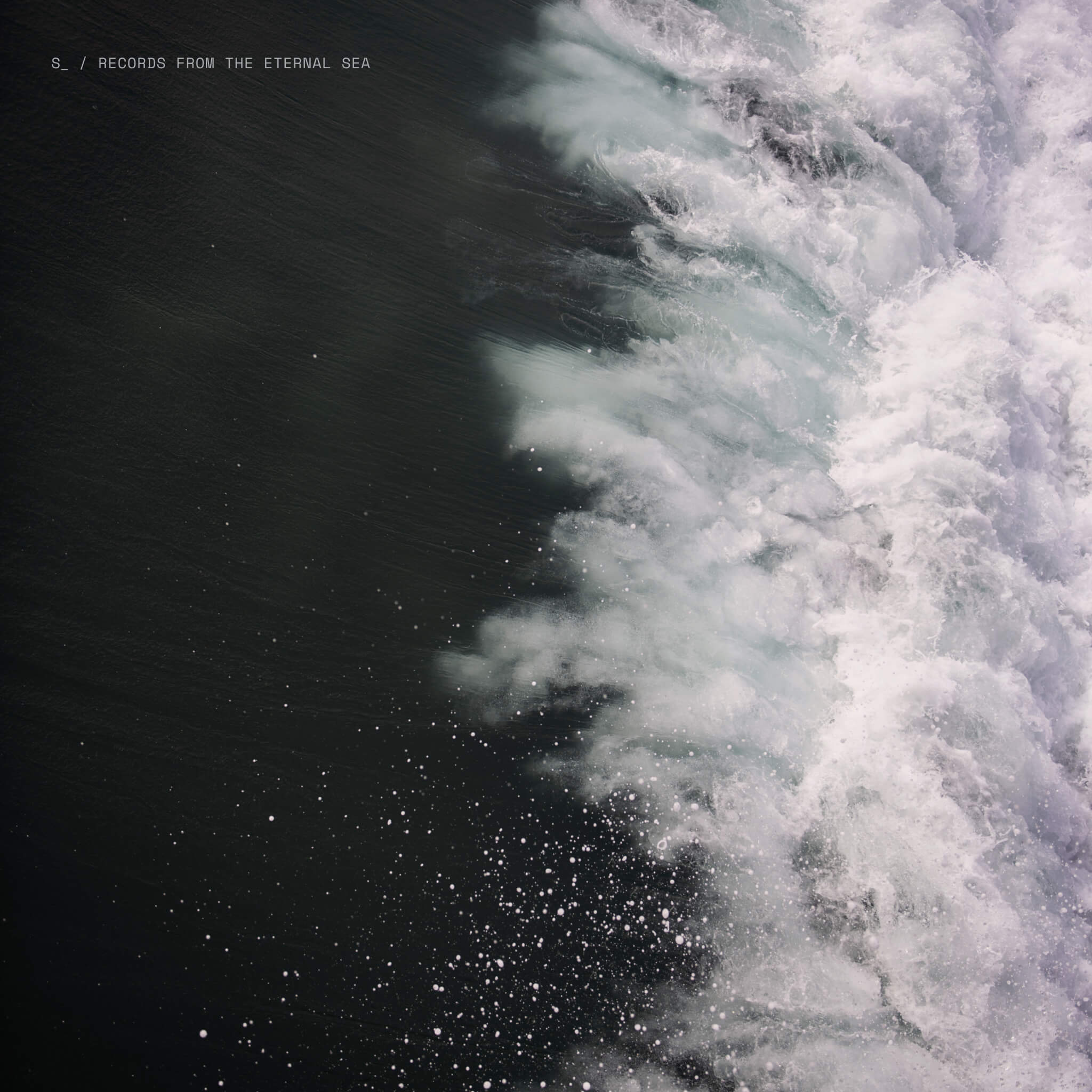 Aerial view of crashing ocean waves for the Records From The Eternal Sea album cover